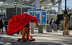 Artist fighting his medium (Tigra K) Tags: london england unitedkingdom gb 2012 actor city color dress people shape funny