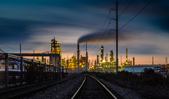If the Brakeman Turns My Way... (fuzzy_dunlop_nola) Tags: longexposure mirrorless fujifilm colorful lights evening colors sunset xt2 louisiana color fuji fujinon refinery traintracks oilrefinery southlouisiana vantage valero norco skyline fujixt2 35mm view smoke chemicals sky night nightfall clouds cloudy cloud weather landscape fujifilmxt2 industrial thebluehour bluehour train light xf35mmf14r scape dusk industry fujix ndfilter neutraldensity norcolouisiana moody dark chemical tracks valerorefinery business bw 6stop lightroom