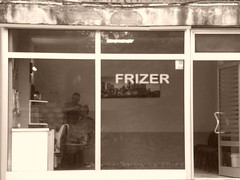 Le coiffeur et le rêve américain.. The hairdresser and the american dream... (alainpere407) Tags: alainpere sepia kosovo pristina coiffeur hairdresser