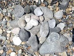 Fifty Shades of Grey on Cantarrijan Nudist Beach (Micheo) Tags: book libro playa chinos pebbles matices shades piedras sonríe smile playanaturistadecantarriján ironia irony