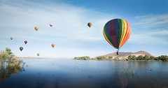 Into the Wild Blue Yonder (ShutterJack) Tags: auldvalley bachelormountain skinnerrecreationarea skinnerreservoir tvbwf temecula temeculavalley winefestival balloon balloons color colorful float hotairballoon lake reflection reservoir summer