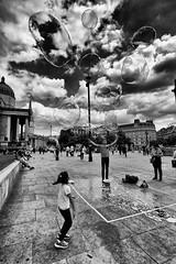 Bubbles (MKHardyPhotography) Tags: london mkhardy trafalgarsquare streetphotography blackandwhite monochrome bubbles streetperformer distagont3518 bw bnw