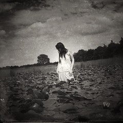 """""""She always had that about her, that look of otherness, of eyes that see things much too far, and of thoughts that wander off the edge of the world"""" (Joanne Harris) (soleá) Tags: darkphotography dark soleá carmengonzález lake swamp water woman ophelia mysterious mystery"""