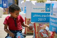 A boy points to the Islamic Relief Ramadan food parcel in Yemen.