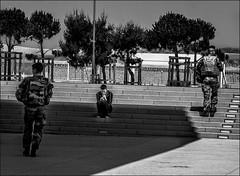 Se faire tout petit..../ Being small... (vedebe) Tags: humain people rue street ville city urbain escaliers soldats militaires noiretblanc netb nb bw monochrome