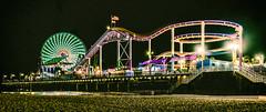 Night was young (ScorpioOnSUP) Tags: california santamonica southerncalifornia amusementpark beach dark ferriswheel flags glow landscape landscapephotography lights longexposure night outdoors pier reflection rollercoaster rollercoasterrides sandybeach urban