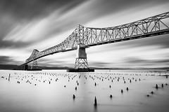 Megler Bridge, Astoria, Oregon (Ron Rothbart) Tags: 10stopfilter astoria columbiariver meglerbridge nd oregon bw blackandwhite bridge clouds longexposure monochrome neutraldensityfilter pilings river water waterfront