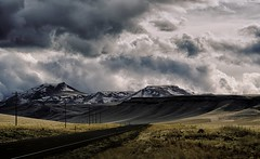 far from home... (Alvin Harp) Tags: bluemountainpass oregon february 2017 stormclouds cloudsstormssunsetssunrises snowcappedmountains telephonepoles openroad mountainrange natureswonder sonyilce7rm2 fe24240mm alvinharp