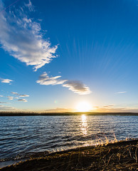 sunset with a splash (Mange J) Tags: k3ii lakevänern magnusjakobsson pentax sigma1020 sverige sweden vänern värmland beach beauty blue clear evening forrest lake life nature pentaxart sky summer sun sundown sunset tree water wave wood värmlandslän se