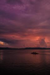 Purple Orange Dawn (kevinrborres) Tags: sunrise dawn purple orange clouds sea seascape boat fishermen fish fishing silhouette goldenhour magichour nature fujifilm xt2