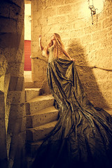 Rapunzel, impatient for her hair to grow, tried a parachute (sophie_merlo) Tags: tower stairs spiral fantasy fairytale model beauty yellow hair fashion woman lady rapunzel castle france