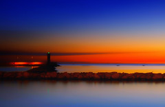 First lights in the harbor (Gio guarda le stelle) Tags: sea seascape harbor sunrise sky italy quiet atmosphere canon landscape longexpo lightroom clouds red orange yellow blue 2470 lungomare porto alba mare notte night 30sec mar luce colors colore firstlight light diamondclassphotographer