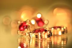 Liquid gold (alideniese) Tags: macro closeup bokeh jewellery earrings jewels smileonsaturday gold red garnets reflection light focus colour shallowdepthoffield