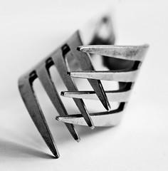 entanglement (kevin towler) Tags: two forks cutlery macro white black blackandwhite stilllife closeup utensil entangled indoor