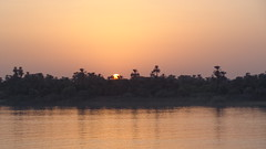 Nile Sunset (Rckr88) Tags: nile sunset nilesunset nileriverupperegypt nileriver upperegypt river upper egypt africa travel travelling sun sunlight rivers riverbank water waves wave reflection reflectionsofthenile reflections thenileriver trees tree nature outdoors