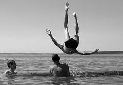 Happy Bathing (sabpost) Tags: teenager beach summer day art person river swim bathing jump fun bw boys lad guys water game log