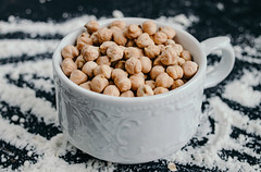 Cup of raw chickpeas (wuestenigel) Tags: hard dry natural place inside beige background healthy diet peeled board text pile black fresh white view cup group wooden stone vegetarian beautiful scoop blue nutrition studio ingredient full chickpeas top raw shot bowl food frame rustic organic