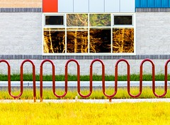 Bold (Karen_Chappell) Tags: school building window curves shapes lines architecture torbay newfoundland nfld canada avalonpeninsula atlanticcanada red yellow blue windows geometry geometric abstract brick bikerack bibyclerack curve rectangle square shape green colourful multicoloured colours colour reflection reflections