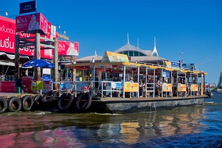 Chang Pier (No. 9) by the Chao Phraya river with a small ferry boat for river crossings in Bangkok, Thailand