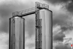 Tower Tanks (BigRedTroll) Tags: architecture bw blackandwhite brewery building england industrial monochrome northampton northamptonshire northants shadow silver sky streetphotography stripes structure tank texture tower vignette