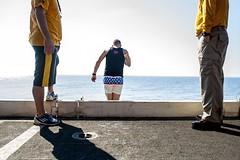 170623-N-AF077-033 (CNE CNA C6F) Tags: gwhb aircraftcarrier 5thfleet georgehwbush swimcall jump water morale ussgeorgehwbush na usa