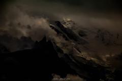 La Gardienne des Ténèbres (Frédéric Fossard) Tags: silhouette montagne paysage nature glacier hautemontagne altitude alpes hautesavoie massifdumontblanc aiguilledumidi lumière ombre atmosphère dramatique ténèbres sombre dark art surréaliste abstrait nuage tourmente orage montblanc sérac