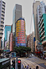 Colorful Buildings (Albert Jafar) Tags: colorfulbuildings hongkongtramway highrisebuildings traffic publictransportation photographerswharf worldtrekker tram