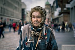 Made Up (Leanne Boulton) Tags: people portrait urban street candid portraiture streetphotography candidstreetphotography streetportrait candidportrait streetlife eyecontact candideyecontact old aged elderly woman female face facial expression look emotion feeling eyes makeup orange teal cinematic fur hood tone texture detail depthoffield bokeh naturallight outdoor light shade shadow city scene human life living humanity society culture fashion canon canon5d 5dmarkiii 70mm character ef2470mmf28liiusm color colour glasgow scotland uk