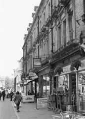 Old facades (Pentax LX HP5) (joshdgeorge7) Tags: buxton ilford hp5 pentax cheshire blackandwhite facades shops buildings architecture