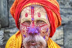 Kathmandu, Nepal (gstads) Tags: kathmandu nepal nepali nepalese india indian pashupatinath sadhu religion religious hindu hinduism pilgrim devotee festival facepaint makeup beard portrait color colour colorful colourful man old mature maturity male gentleman closeup asia asian saddhu ascetic spiritual spirituality sannyasi saffron holy holiness karma asceticism vaishnava vairagya mantra mahashivaratri shivaratri