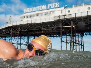 Swimming club member mark swimming past Brighton Pier