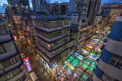 Temple Street Market, Hong Kong (mikemikecat) Tags: temple street yau ma tei market 佐敦 油麻地 hongkong nightscapes a7r nostalgia house mikemikecat architecture sony stacked building colorful housing 城市 天際線 戶外 block hong kong nightview night 夜景 香港 evening vintage jordanroad cityscape urban people 攤販 商店 fe1635mm sel1635z 廟街 rooftop 單眼佬涼茶