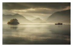 Cut Through the Mist (Vemsteroo) Tags: lakedistrict thelakes cumbria derwentwater derwent landscape mist fog atmospheric boat canon 5d mkiii 70200mm morning sunrise dawn light reflection fells outdoors adventure island autumn golden
