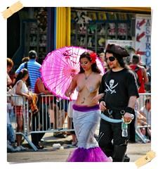 """Pirates, Mermaids, Umbrellas…"" (Alexxir) Tags: mermaid day parade purplefishscaleskirt sword boardwalk pasties topless breasts tonedbody cute asian hot timid friendly brooklyn newyork photography streetphotography alexxir public people"