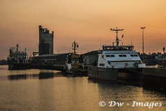 Sun set over Lowestost harbour.2017._wm (madmax557) Tags: suffolk suffolkcoast eastanglia eastcoast eveningsky sunset lowestoftharbour lowestoft uk england ship water waterways shipping lowestoftshipping boats workingboats silhouettes