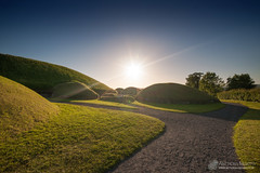 Knowth summer sunset (mythicalireland) Tags: knowth passagetomb summer evening sunset setting sun light sky grass mounds monument megalithic neolithic stone age ancient prehistoric landscape boyne valley meath ireland