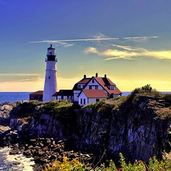 Vacationland (Bets<3 Fine Artist ~Picturing Light ~ Blessings ~~) Tags: maine lighthouse sky plane clouds ocean atlantic rocky coastline rocks water surf sun summer architecture newengland usa