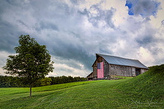 Storms Roll in Over Old Glory (Jericho Hills Photography) Tags: americam flag old glory 4th july indendence day barn farm wooden texture rural weathered paint timber structure vintage rough countryside building architecture american abandoned antique painted red traditional scenic aging obsolete faded oldfashioned beautiful pastoral classic life decay dairy dilapidated distressed barnwood scene rundown copy space john vose jericho hills photography new england hartland vt vermont nature