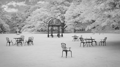 A Ghostly Gathering (Glenn D Reay) Tags: beamish hotel chairs infrared 720nm lawn eerie ghostly surreal olympus olympusep1 olympus1442iir glennreay
