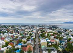 Reykjavik - the view from the tower of Hallgrímskirkja church (krøllx) Tags: buildings city colorful colors europe houses iceland landscape mountain nordic ocean reykjavik scandinavia sea viewfromhallgrímskirkjastower water 20170613dsc05032