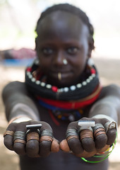 Sudanese Toposa tribe girl refugee showing her hand rings, Omo Valley, Kangate, Ethiopia (Eric Lafforgue) Tags: 1011years africa anthropology beaded beads beautifulpeople blackpeople child day decoration developingcountry eastafrica ethiopia ethiopia0617294 ethiopian feminine focusonforeground hands hornofafrica humanbodypart indigenousculture jewel jewelry kangate lookingatcamera necklaces omovalley onegirlonly outdoors refugee rings scars sudanese toposa traditionalclothing tribal tribe tribeswoman vertical