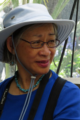 Melody sitting in lobby of Conservatory of Flowers building in San Francisco's Golden Gate Park 170621-131747 C4 (Wambeke & Wambeke Photography, Art, & Textiles) Tags: melody melodychandosswambeke portrait womanwearinghat womanwearingglasses portraitofawoman goldengatepark conservatoryofflowersbuilding womentouchingheads charliewambekephotography charliesphotoart charliewambekephoto charliewambekephotograph charliesphotoartcom canonpowershotsx50photograph canonsx50photograph canonsx50photo wambekewambekephotographyarttextiles wambekewambeke wambekeandwambekephoto wambekeandwambekephotography wambekewambekephotographyquiltingspecialists