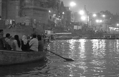 Ganges Boat Trip At Night (peterkelly) Tags: bw digital india asia canon 6d gangesriver river water wooden boat oar rowboat varanasi lights night evening pujaceremony rowing shore people