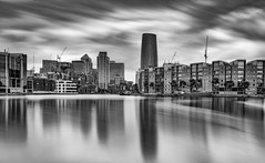Gotham City (Aleem Yousaf) Tags: gotham city black white monochrome london docklands mudchutte millwall outer dock marina inner canary wharf construction cranes long exposure cityscape lee filters big stopper graduated filter neutral density water silky smooth clouds sky reflections gothic architecture nikon holy trinity 2470mm cityview photo walk