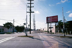 Railroad - L.A. (Pietro Bakke) Tags: yashica fx3 fx 3 35mm film films rullino rullini filmphotography photos photography photoshop lightroom lightmeter bakke7 pietro bacherotti trip holiday holidays vacation vacanze vacanza lavoro business travel california socal iso iso200 200 pose composizione composition los angeles sign zeiss 50mm f17 planar 28mm f28 28 17 50 mm lens analogic analogica 80s 1980 railroad railway road treno ferrovia passaggio livello downey la high voltage highvoltage pylons