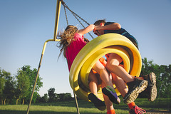 Three is never a crowd (our_little_utopia) Tags: tire swing playing children playground child fun laughter siblings ourlittleutopia