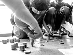 Counting (A. Yousuf Kurniawan) Tags: people streetphotography streetlife blackandwhite monochrome activity charity coin count money peoplepower decisivemoment