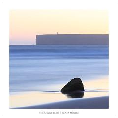 The Sea of Blue (Beata Moore) Tags: atlantic ocean sea blue sunset portugal beatamoore rock lighthouse cool mood atmospheric