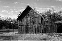 Barn (HJharland5) Tags: barn ground pebbles sky monochrome wood door