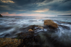 Wet (T_J_P) Tags: beach cornwall rocks sea ocean tide clouds light sunset seascape sennen coast
